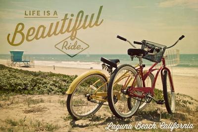 https://imgc.allpostersimages.com/img/posters/laguna-beach-california-life-is-a-beautiful-ride-beach-cruisers_u-L-Q1GQLFK0.jpg?artPerspective=n