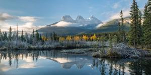 Lake with mountains in background, Beaverlodge, Three Sisters, Canmore, Alberta, Canada