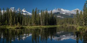 Lake with mountains in background, Three Sisters Mountain, Mount Lawrence Grassi, Canmore, Alber...
