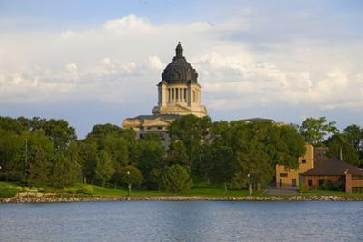 Lake with view of South Dakota State Capitol and complex, Pierre, South Dakota, built between 19...