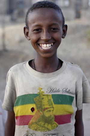 https://imgc.allpostersimages.com/img/posters/lalibela-boy-wearing-a-haile-selassie-t-shirt-lalibela-wollo-ethiopia_u-L-Q1GYHDJ0.jpg?artPerspective=n