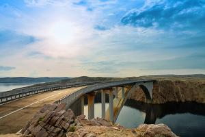 Bridge to the Pag Island with Sun and Clouds, Croatia by Lamarinx