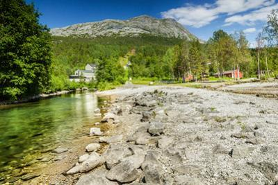 Long Exposure Shot of A Stream and A Mountain Peak in Northern Norway by Lamarinx