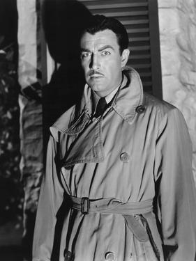 Lame by fond UNDERCURRENT by VincenteMinnelli with Robert Taylor, 1946 (b/w photo)