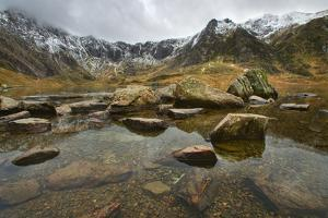 'Still Waiting on Winter' - Cwm Idwal, Snowdonia by Landscapes by Kris Williams