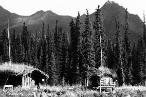 Alaska - View of Trapper's Cabin and Cache by Lantern Press