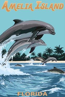 Amelia Island, Florida - Dolphins Jumping by Lantern Press
