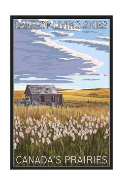 Canadas Praires - Land of Living Skies - Wheat Field and Shack by Lantern Press