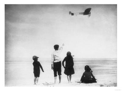 Children Watching Louis Bleriot Flying Plane Photograph - Calais, France by Lantern Press