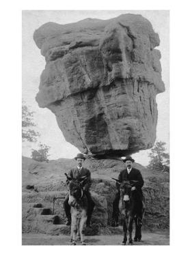 Colorado Springs, CO - Garden of Gods Balanced Rock, Men on Burros by Lantern Press