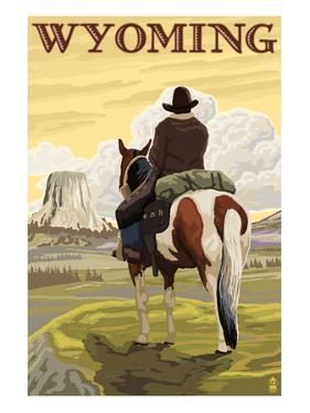Cowboy and Devil's Tower - Wyoming by Lantern Press