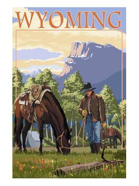 Cowboy and Horse in Spring - Wyoming by Lantern Press