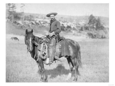 Cowboy on His Horse Photograph - South Dakota by Lantern Press