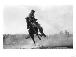 Cowboy riding Bronco in Burns, OR Rodeo Photograph - Burns, OR by Lantern Press