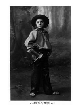 Cowgirl Portrait - Miss Rita Leggiero Holding a Knife by Lantern Press