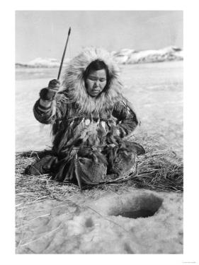 Eskimo Woman Fishing through Ice in Alaska Photograph - Alaska by Lantern Press