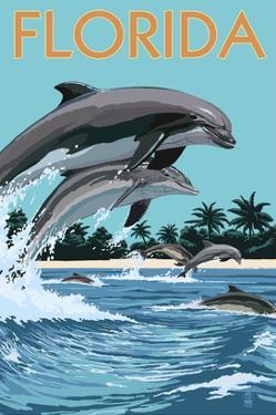 Florida - Dolphins Jumping by Lantern Press