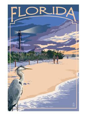 Florida - Lighthouse and Blue Heron Sunset by Lantern Press