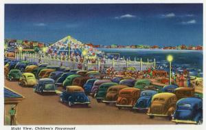 Hampton Beach, New Hampshire, View of the Children's Playground at Night by Lantern Press