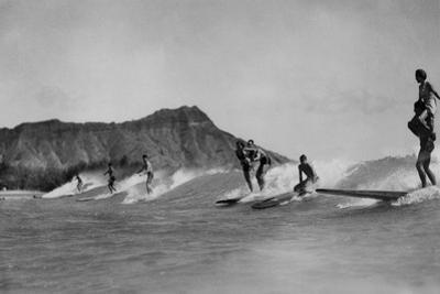 Honolulu, Hawaii - Surfers off Waikiki Beach Photograph by Lantern Press