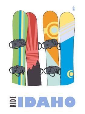 Idaho, Snowboards in the Snow by Lantern Press