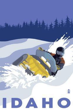 Idaho, Snowmobile Scene by Lantern Press