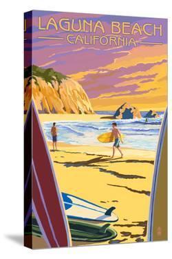 Laguna Beach, California - Surfers at Sunset by Lantern Press