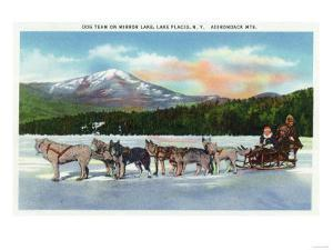 Lake Placid, New York - View of a Dogsled Team on Mirror Lake during Winter by Lantern Press