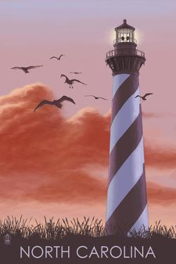 North Carolina - Lighthouse at Sunrise by Lantern Press