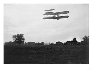 Orville Wright Flies High in the Sky Photograph - Dayton, OH by Lantern Press