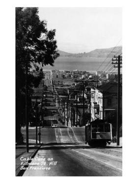San Francisco, California - Cable Cars on Fillmore Street Hill by Lantern Press