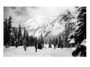 Snoqualmie Pass, Washington, View of Skiers Skiing during the Winter by Mountain by Lantern Press