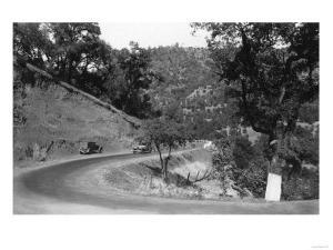 View of Model-T Fords on Redwood Highway - Hopland, CA by Lantern Press