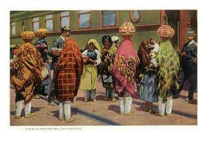 View of Pueblo Women Selling Pottery by a Train by Lantern Press