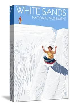 White Sands National Monument, New Mexico - Sledding on Sand by Lantern Press
