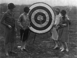 Women examining Archery Target Photograph - Washington, DC by Lantern Press