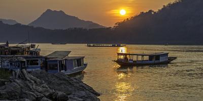 https://imgc.allpostersimages.com/img/posters/laotian-fishing-village_u-L-Q13D2K30.jpg?p=0