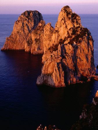 https://imgc.allpostersimages.com/img/posters/large-rocks-on-coast-capri-italy_u-L-P3SATI0.jpg?p=0