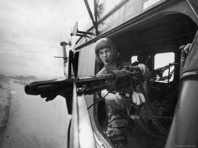 Crew Chief Lance Cpl. James C. Farley Manning Helicopter Machine Gun of Yankee Papa 13