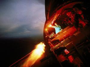 Crew of Us Ac-47 Plane Firing 7.62 Mm Ge Miniguns During Night Mission in Vietnam by Larry Burrows