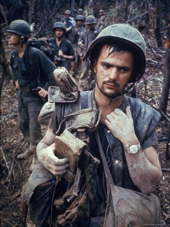 Dirty, Exhausted Looking US Marine on Patrol with His Squad Near the DMZ During the Vietnam War