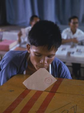 Disabled South Vietnamese Soldier Casting a Vote into a Ballot Box at Cong Hoa Army Hospital by Larry Burrows