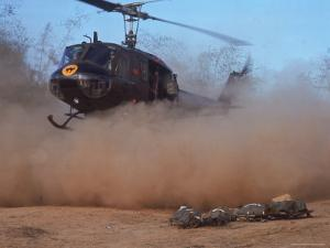 Helicopter Touching Down to Retrieve Bodies of Soldiers Killed in Firefight During the Vietnam War by Larry Burrows