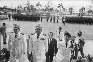Maj. Gen. Thien Khiem (L), Gen. Van Minh Duong (2L), and Gen. Khanh Saigon, Vietnam, 1964 by Larry Burrows