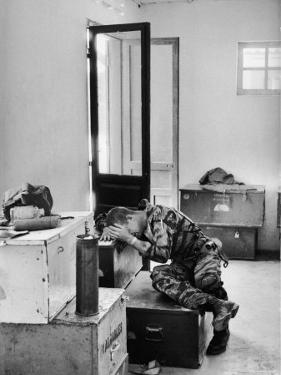 Marine Lance Corporal James C. Farley Crying in Office over Death of Friends During Vietnam War by Larry Burrows