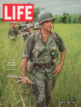 Soldiers Walking Through Grass in Vietnam, June 12, 1964 by Larry Burrows