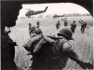 US Marines 163rd Helicopter Squadron Discharging South Vietnamese Troops for an Assault by Larry Burrows
