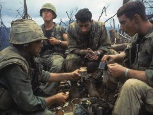 US Marines Eating Rations During a Lull in the Fighting Near the Dmz During the Vietnam War by Larry Burrows