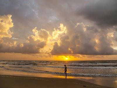 Person walking on beach, South Padre Island.