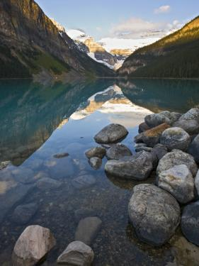 Rocky Mountains and Boulders Reflected in Lake Louise, Banff National Park, Alberta, Canada by Larry Ditto